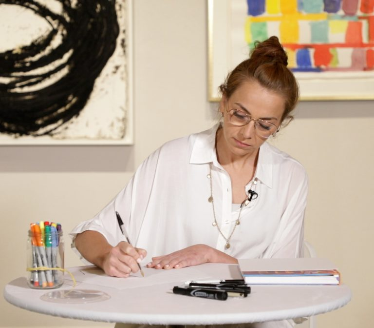 Woman creating art piece.